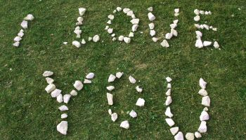 High Angle View Of I Love You Text Made From White Stones On Field